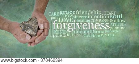 Love And Forgiveness Word Tag Cloud -  Male Hands Gently Cupped Around A Wooden Heart Beside A  Forg
