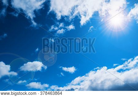 Blue sky background. Sunset clouds lit by evening soft sunlight. Vast sky landscape panoramic scene, bright sunset sky view, sky background