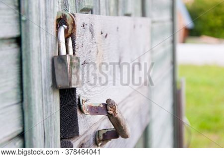 The Old Lock Was Used To Lock Old Wooden Doors. The Steel Silver Lock Reliably Locks Old Doors, Door