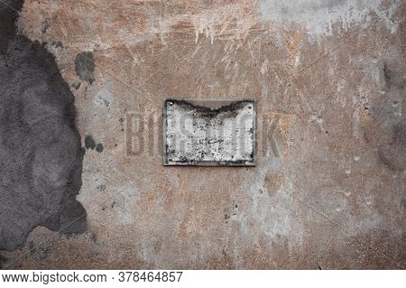 Old shabby plaque on the wall, antique background