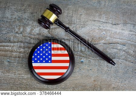 Wooden Judgement Or Auction Mallet With Of Usa Flag. Conceptual Image.
