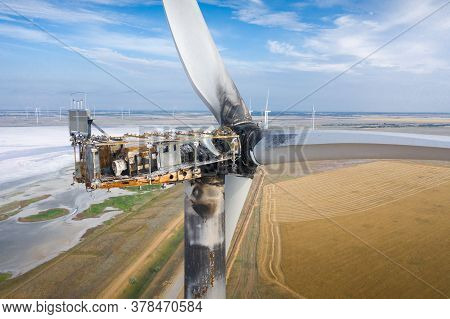 The Wind Farm Was Damaged By Lightning.