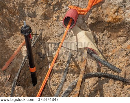 Construction Trench With Electrical Wires. Road Work For The Installation Of Fiber Optic Cables For