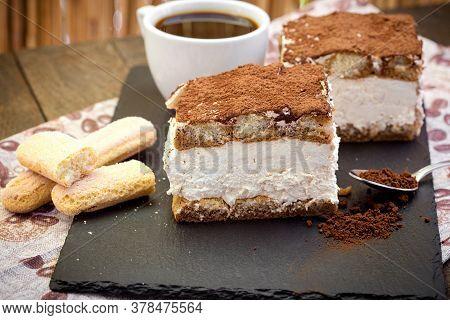 Italian Tiramisu, Delicious Creamy Dessert (treat) And Cup Of Coffee For Your Pleasure