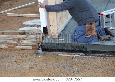 Builder Installing A Prefabricated Wall