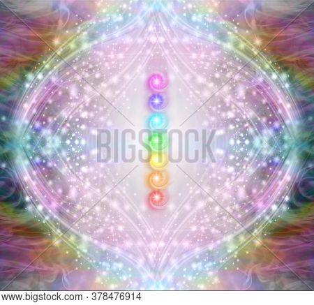 Vibrant Shimmering Seven Chakra Stack - A Vertical Row Of Seven Rainbow Coloured Energy Chakras Agai