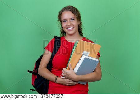 Laughing German Female Student With Red Shirt Isolated On Green Background