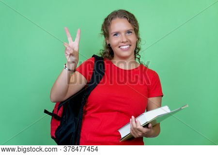 Pretty German Female Student With Red Shirt Isolated On Green Background