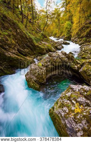 Slovenia. Picturesque Vintgar Gorge, canyon in the Julian Alps. The azure waters of the river Radovna flow between the steep cliffs. The concept of active, environmental and photo tourism