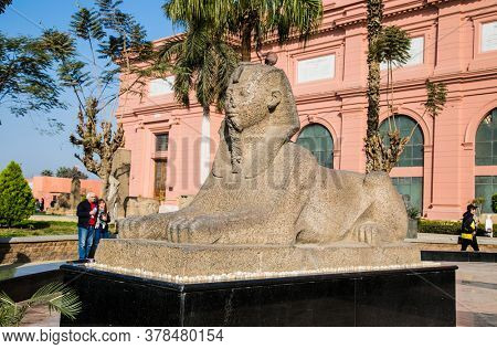 Cairo, Egypt - Jan 31, 2020: Statue in fromt of Egyptian Antiquities museum, known commonly as the Egyptian Museum or Museum of Cairo, Cairo, Egypt