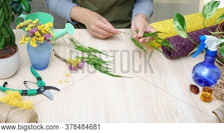 Floristry. Florist At Work. Woman Making Bouquet Of Flowers.