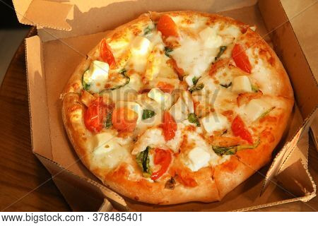Freshly Baked Delivery Pizza Close Up In Plain Open Box