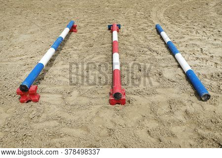 Image Of Poles On Empty Training Field. Wooden Barriers For Horses As A Background. Colorful Photo O