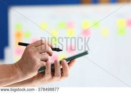 They Hold Smartphone And Pen For Electronic Signature In Their Hand. Modern Technologies And Applica