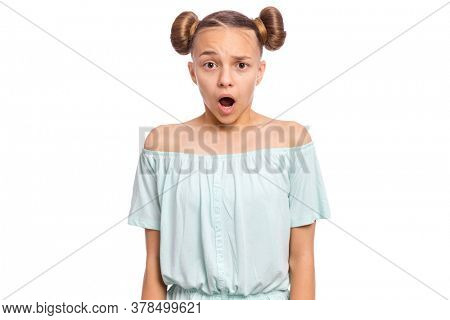 Portrait of surprised teen girl, isolated on white background. Funny child looking at camera in amazement. Beautiful caucasian teenager, opening eyes and mouth with shock.