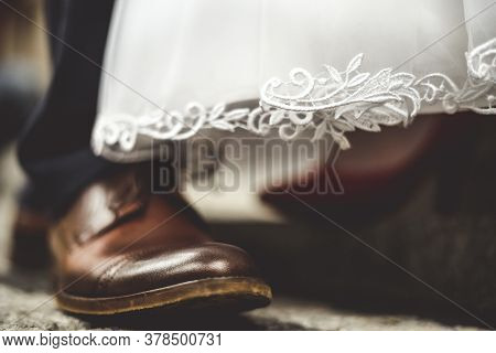 Close Up Of Bride And Groom Shoes.