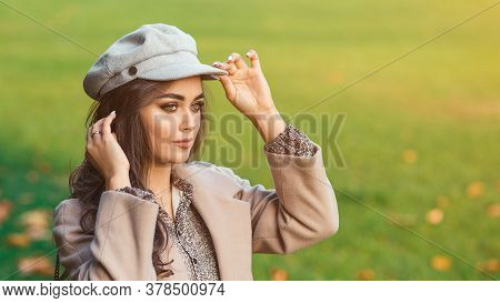 Fashionable Woman Walking In Autumn. Female With Luxury Makeup, Long Curly Hair In Stylish Outfit. F
