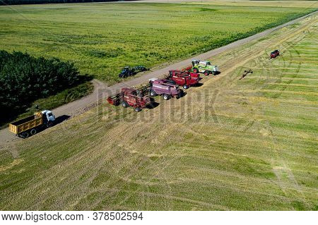 Belarus - July 2020:  Combine Harvesters In The Middle Of The Field Preparing For Harvesting Top Vie