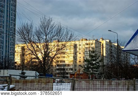 Houses Against The Background Of A Winter Sunset, Moscow