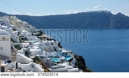 View Of The Island And Whitewashed Village Of Oia Of Santorini, Greece.