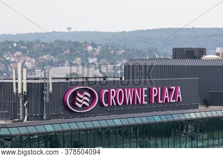 Belgrade, Serbia - June 23, 2019: Crowne Plaza Sign At Top Of Hotel Building In Belgrade Serbia.