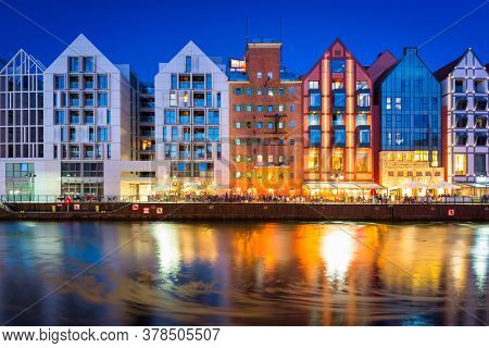 Architecture of the granaries island in Gdansk at night, Poland