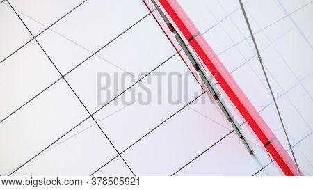 Commercial Building Wall With White Blocks And Red Decorative Line Located In City Centre Under Brig