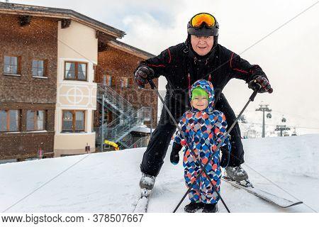 Senior Young Heart Grandfather Man With Grandson Toddler Kid Having Fun Enjoy Skiing Sport Vacation