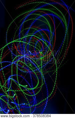 Photo Of A Christmas Garland On A Long Shutter Speed. Abstract Background Of Christmas Lights With L
