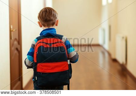 Back View Of Schoolboy With Backpack. Sad Child Going Home. Elementary School, Back To School Concep