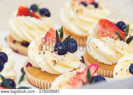 Holidays Cupcakes With Strawberry And Blueberry, Close Up. Cupcakes Packaging, Delivery Box.