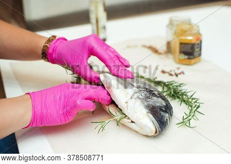 Women's Hands Are Preparing Dorada Fish For Dinner. Preparation For Cooking Fish Food. Fish With Aro