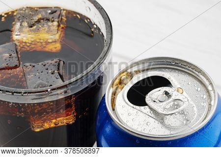 Open Aluminum Can And Glass Of Cola Isolated On White