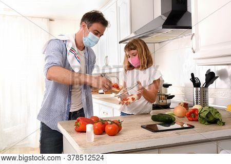 Happy Father And Daughter Preparing Vegetables To Make A Plate Of Food Confined By Covid-19 At Home