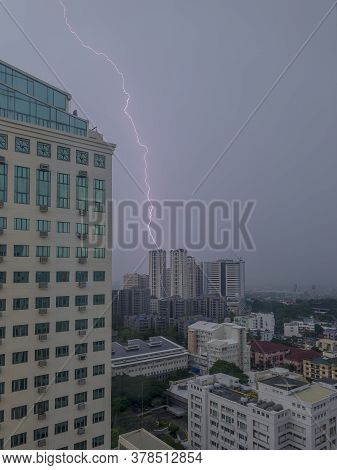 Flash Hits A Highrise Building During A Thunderstorm In Manila