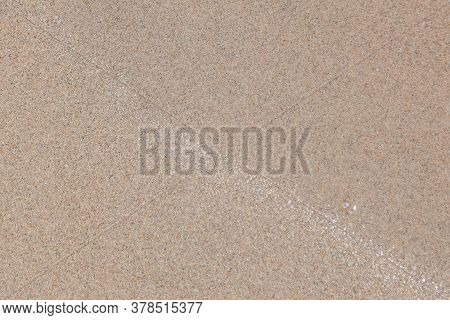Close-up Of A River Bank Made Of Beige-gray Sand With Particles Of Old Shells Of Shells, Design Of A