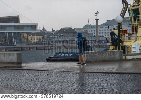 Helsingborg, Sweden - July 26, 2020: A Rainy Summer Day. People Run For Shelter