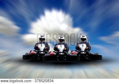 Three Riders Go Kart Speed Rive Indoor Race Against A Blue Sky With Clouds. Copy Space. Go Kart Indo
