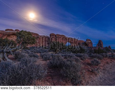 Panoramic Picture Of Impressive Sandstone Formations In Arches National Park At Night In Winter