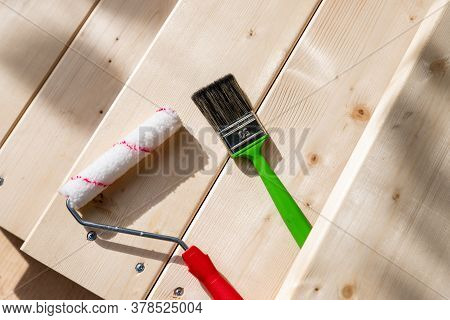 Set Of Tools For Painting On Wooden Backgrond.painting Wall By The Roller Brush For Protection And C