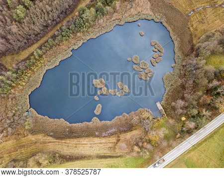 Aerial Image Of A Pond With Floating Mats, Which Were Cut Of From Peat Block Covered With Growing Sh