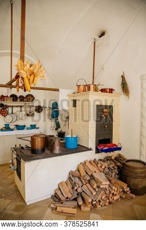 Ancient Copper Tableware Stands In The Kitchen On A Larger Antique Oven, Castle Interiors, Bitov Cas