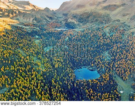 Aerial Photograpy Over The Val Di Campo (campo Valley) With The Heart-shape Saoseo Lake And Viola La