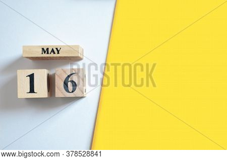 May 16, Empty White - Yellow Background With Number Cube.