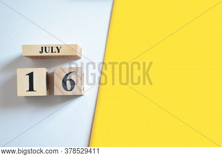 July 16, Empty White - Yellow Background With Number Cube.