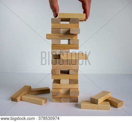 Wood Block Tower With Architecture Model. Concept Risk Of Management And Strategy Plan, Growth Busin