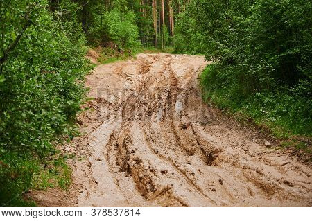 Dirty Blurry Dirt Road With Tire Tracks In Spring. Off-road.