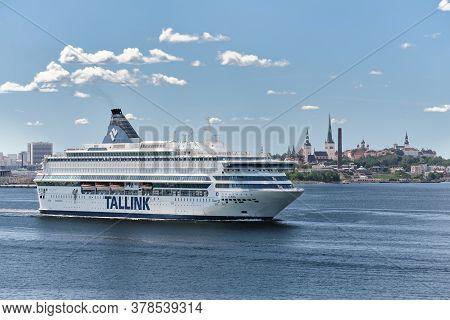 Tallinn, Estonia - July 26, 2020: Tallink Cruise Ferry Ship On The Old Tallinn Background