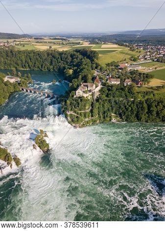 Aerial View By Drone Of Rhine Falls With Schloss Laufen Castle, Switzerland. Rhine Falls Is The Larg