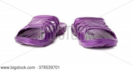 Pair Of Cheap Durable Purple Rubber Slippers Isolated On White Background.